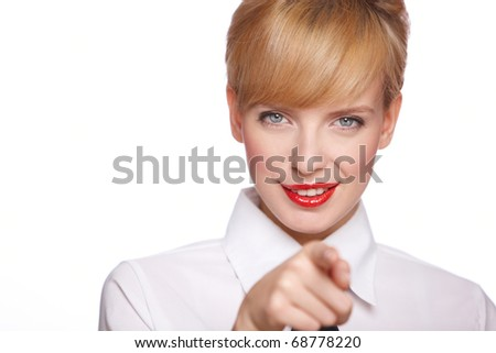 Portrait of beautiful young sexy businesswoman, she pointing at you - stock photo