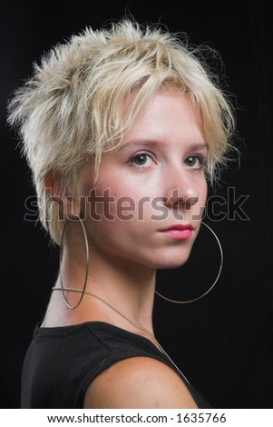 Portrait of beautiful young sexy woman on black background - head shot - stock photo