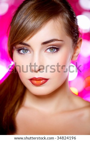 Portrait of beautiful young sexy woman on red background - stock photo