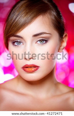 Portrait of beautiful young sexy woman on red background