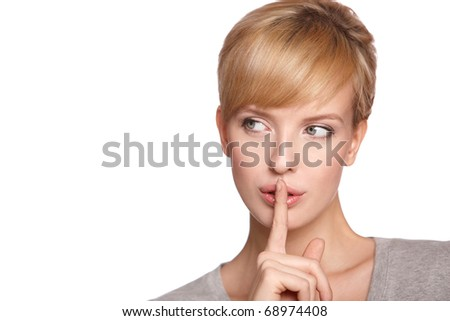 Portrait of beautiful young sexy woman, she doing quiet gesture, looking at copyspace - stock photo