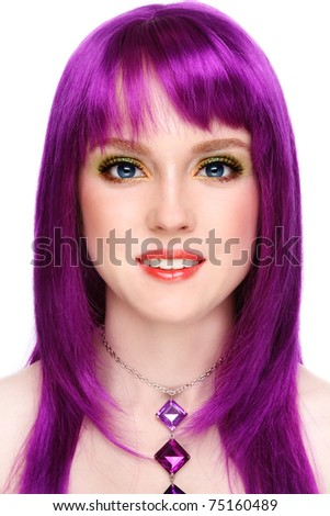 Portrait of beautiful young smiling girl with fancy bright make-up and violet wig, on white background - stock photo