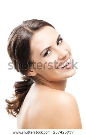 Portrait of beautiful young smiling woman, isolated against white background - stock photo
