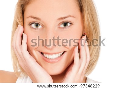 Portrait of beautiful young smiling woman stroking her pretty face with healthy skin isolated on white background - stock photo
