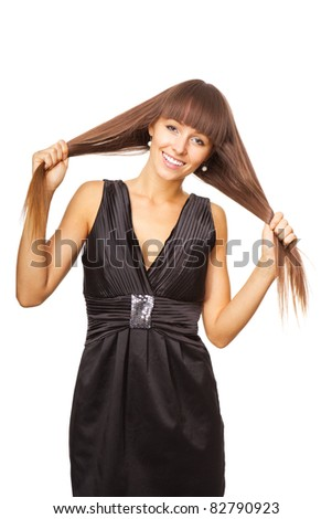 Portrait of beautiful young smiling woman that keeps hands strands of hair