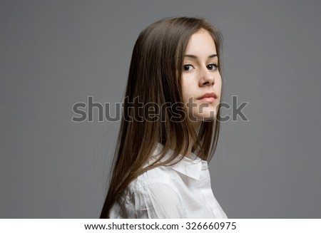 Portrait of beautiful young teen with serious expression.