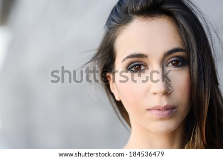 Portrait of beautiful young woman - stock photo