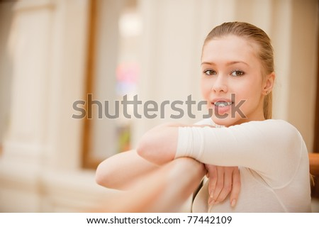 Portrait of beautiful young woman at handrail. - stock photo