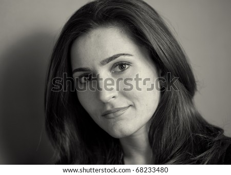 Portrait of beautiful young woman black and white sepia - stock photo