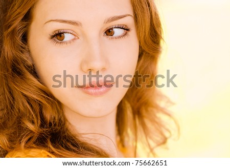 Portrait of beautiful young woman close up. - stock photo