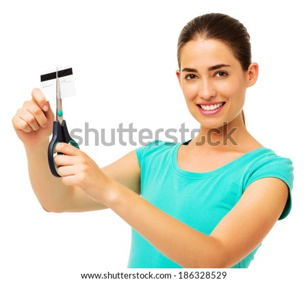 Portrait of beautiful young woman cutting credit card with scissor over white background. Horizontal shot. - stock photo