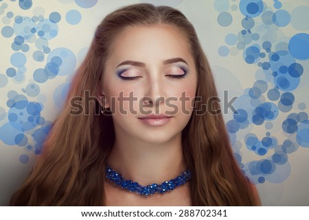 Portrait of beautiful young woman dreamer, girl, woman, model, star, celebrity, mermaid. Grey background. Bright creative makeup, perfect eyebrows, expressive eyes, pink, blue. Hair, color experiment - stock photo