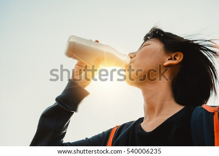 Portrait of beautiful young woman drinking milk