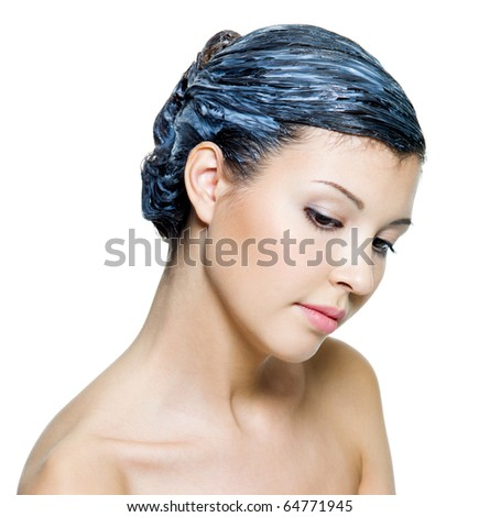 Portrait of beautiful young woman dyeing hairs - isolated on white - stock photo