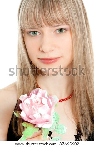 Portrait of beautiful young woman holding a flower smiling - stock photo
