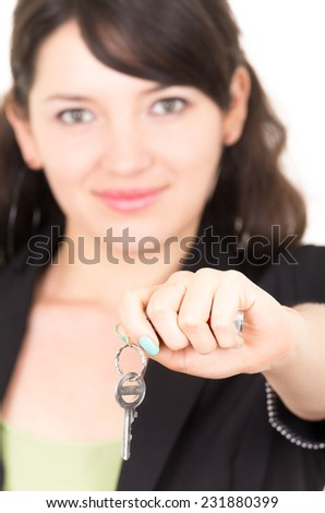 portrait of beautiful young woman holding key concept of sale opportunity realtor investment isolated on white selective focus - stock photo