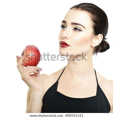 Portrait of beautiful young woman holding red apple near her face over white background. Eva. - stock photo
