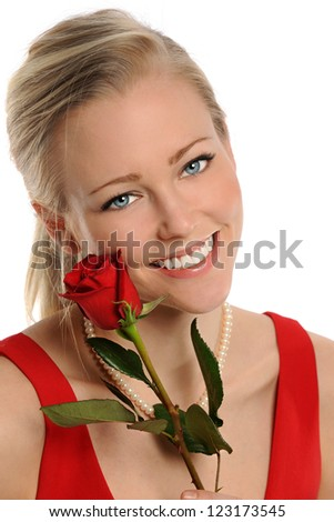 Portrait of beautiful young woman holding red rose isolated over white background