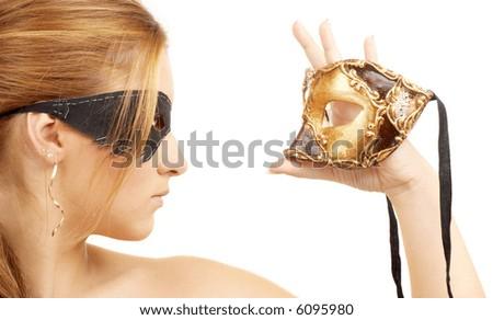 portrait of  beautiful young woman holding venetian carnival mask - stock photo