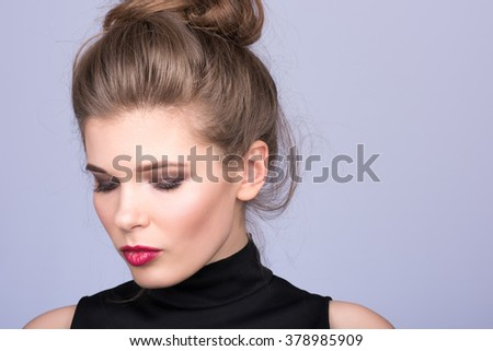 Portrait of beautiful young woman in a black turtleneck. Look down - stock photo