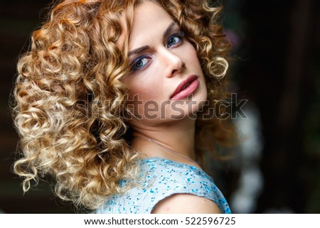 portrait of beautiful young woman in a casual top and skirt with perfect makeup and hair style