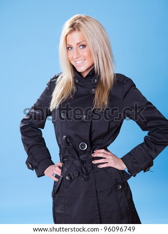Portrait of beautiful young woman in autumn/winter coat - stock photo