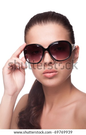 Portrait of beautiful young woman in big fashion sunglasses - stock photo