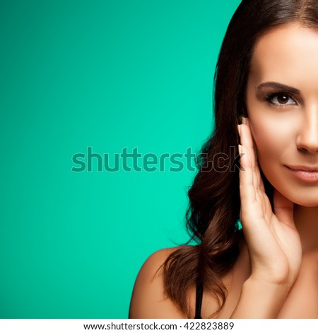 Portrait of beautiful young woman in black tank top clothing, with copyspace, on green background - stock photo
