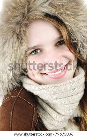 Portrait of beautiful young woman in fur hood of winter coat - stock photo