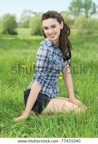 Portrait of beautiful young woman in nature