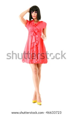 Portrait of beautiful young woman in pink mini dress isolated on white background - stock photo