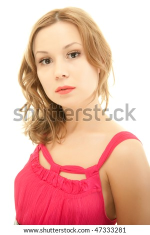 Portrait of beautiful young woman in red dress