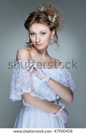 portrait of beautiful young woman in white dress - stock photo