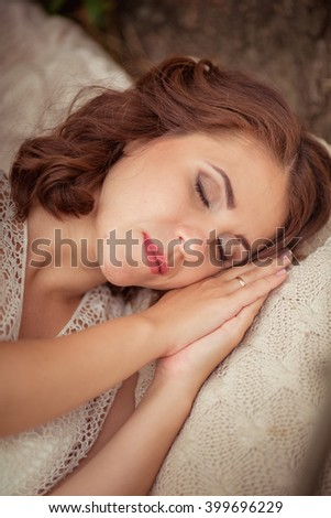 Portrait of beautiful young woman is sleeping in a tent