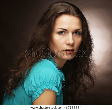 portrait of beautiful young woman, isolated over beige  background - stock photo