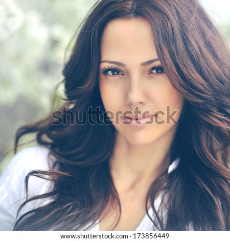 Portrait of beautiful young woman looking at camera - stock photo