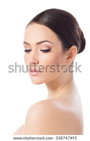 Portrait of beautiful young woman looking at camera, isolated on white