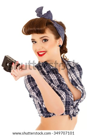 Portrait of beautiful young woman making photo with retro camera on a white background. - stock photo