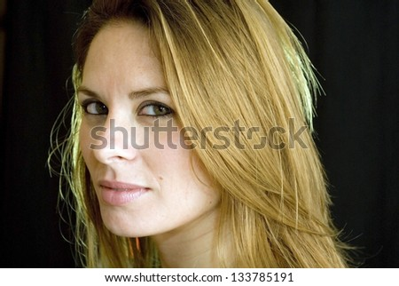 Portrait of beautiful young woman on black background