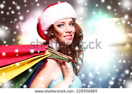 Portrait of beautiful young woman on bright background - stock photo