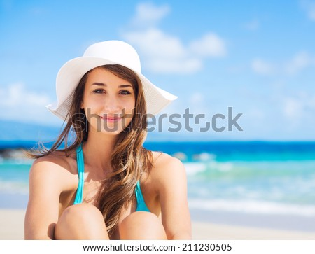 Portrait of beautiful young woman on the beach - stock photo