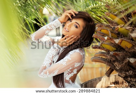 Portrait of beautiful young woman outdoor - stock photo