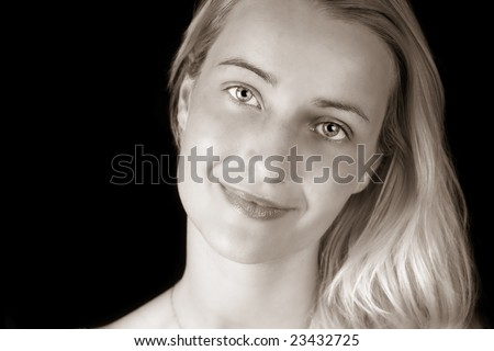Portrait of beautiful Young Woman over Black