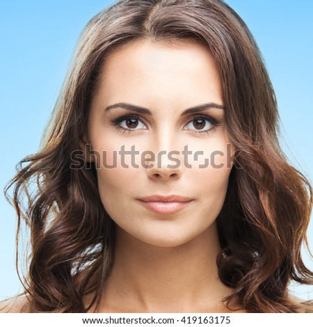 Portrait of beautiful young woman, over blue background - stock photo