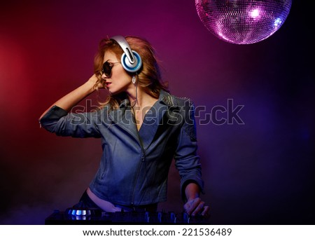 Portrait Of Beautiful Young Woman Playing Dj In Disco