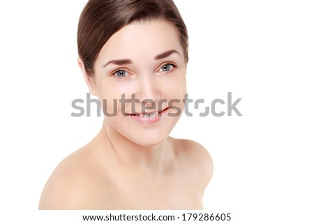 Portrait of Beautiful Young Woman posing in studio