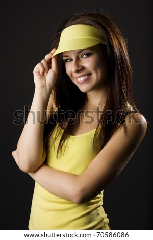 Portrait of beautiful young woman posing on dark background - stock photo