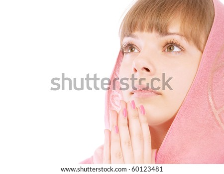 Portrait of beautiful young woman praying, isolated on white background.