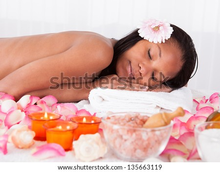 Portrait Of Beautiful Young Woman Relaxing In Spa - stock photo
