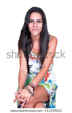 Portrait of beautiful young woman sitting isolated over white background - stock photo